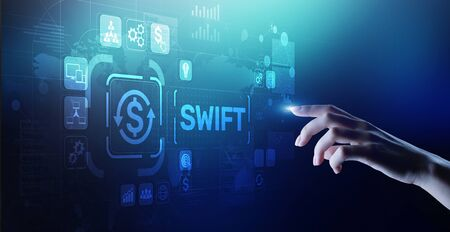 SWIFT international payment system financial technology banking and money transfer concept on virtual screen. Banque d'images - 130053198