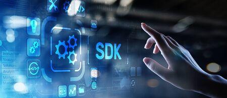 SDK Software development kit programming language technology concept on virtual screen. Фото со стока