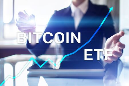 Bitcoin ETF, Exchange traded fund and cryptocurrencies concept on virtual screen.