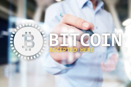 Bitcoin accepted here text and logo on virtual screen. Online payment and cryptocurrency concept.