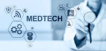 Medtech medical technology information integration internet big data concept on virtual screen. Doctor with stethoscope.