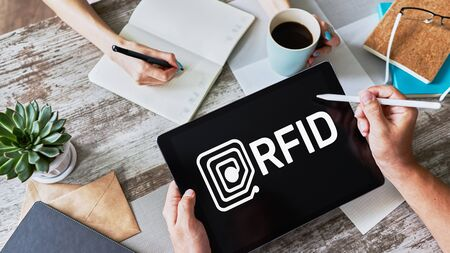RFID Radio frequency identification technology concept on device screen. Security and automation. Stok Fotoğraf