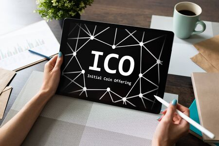 ICO - Initial coin offering. Blockchain and financial technology concept. Stock Photo