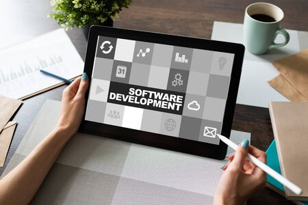 Software development and process automation concept on tablet computer screen.
