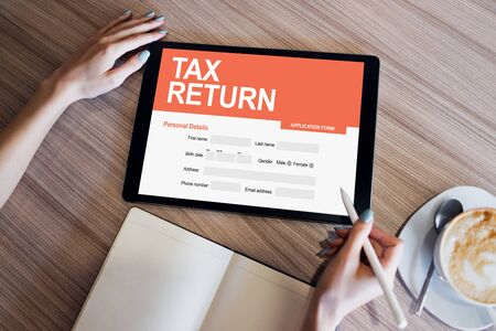 Online tax return application on screen. Business and finance concept.