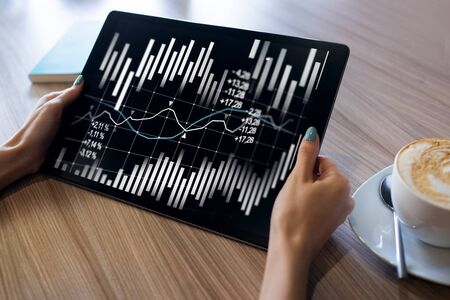 Financial graphs and charts on screen. Forex and stock market trading. Return on investment. Banco de Imagens