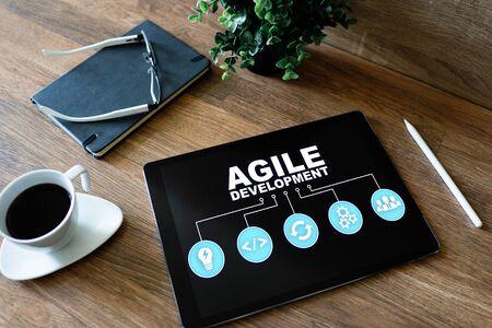 Agile development concept on the device screen. 写真素材