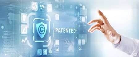 Patented intellectual property right management concept patent button on virtual screen. Stock fotó