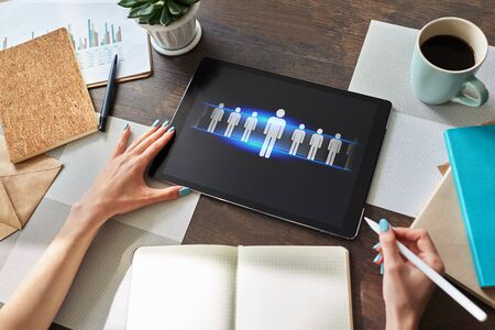 HR, Human resource management, teamwork, recruitment concept on device screen. Stockfoto