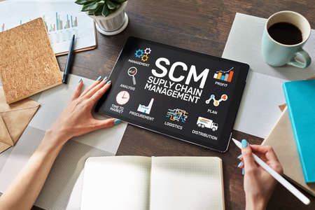 SCM - Supply Chain Management and business strategy concept on the screen.