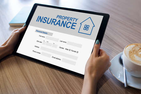 Property insurance online application form. Business and internet concept.