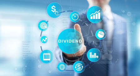 Dividends button on virtual screen. Return on Investment ROI financial business wealth concept.