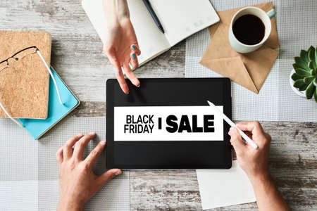 Black friday sales banner on device screen. E-commerce, internet business and digital marketing