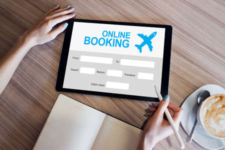 Online flight booking service form on device screen Imagens