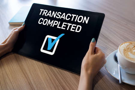 Transaction completed message on screen. Digital banking and online payment concept