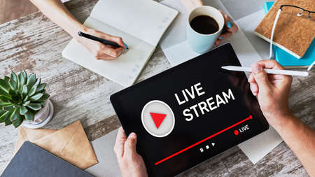 Live stream transmit or receive video and audio coverage over the Internet. Digital marketing and advertising concept Imagens
