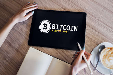 Bitcoin accepted here sign on screen. E-payment, Cryptocurrency and financial technology concept
