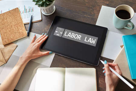 Labor law icon and text on device screen