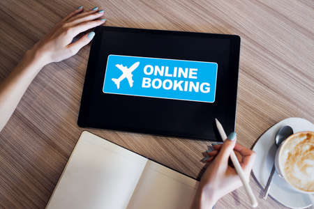 Flight ticket booking online service on device screen. Internet and technology concept