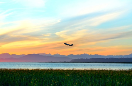 atmospheric pressure: Sunset. Sunset Sky. A plane is attempting to climb in the sunset sky. Stock Photo
