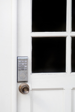 PIN keypad with numbers in the wooden door  photo
