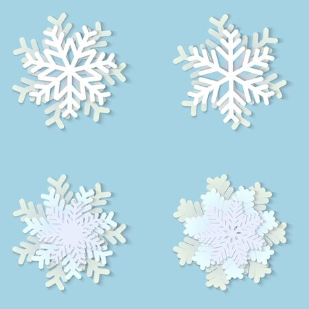 Vector set of white Christmas paper snowflakes with shadow on blue background. Holiday, New year and Christmas design elements