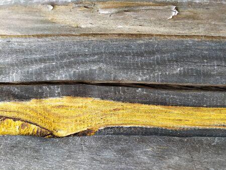 Dark brown scratched wooden board. Wood texture Imagens
