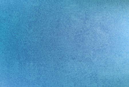 Frozen window hoarfrost on blue background.