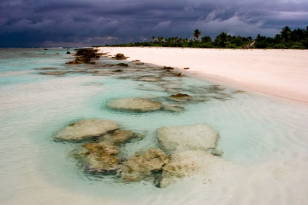 Turquoise waters of Pacific on atoll Fakavara, French Polynesia  photo
