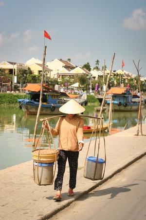 fish vendor: Vietnamese sellerwoman on the street, Hoi An, Vietnam  Stock Photo