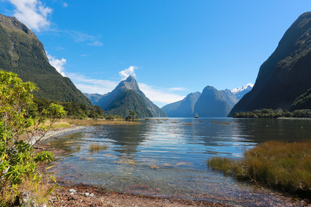mitre: Mitre Peak rising from the Milford Sound fiord and reflecting in water. Fiordland national park, New Zealand
