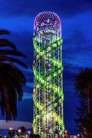 The Alphabetic Tower in its night illumination. It is a 130-meter-high tower in Batumi, Georgia, built to symbolize the unique Georgian alphabet. The tower is built with the double helix pattern, similar to DNA's.