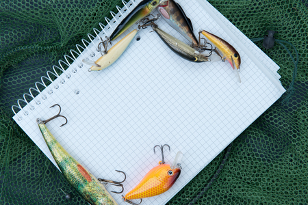 fishing accessories and a paper notebook
