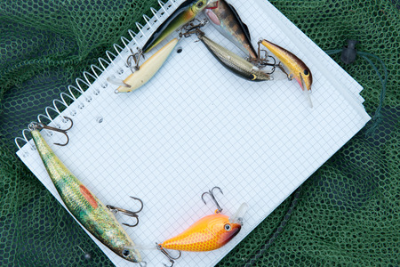 fishing accessories on a green net Stock Photo