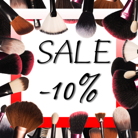 Sale on background with professional makeup tools Standard-Bild - 97360275