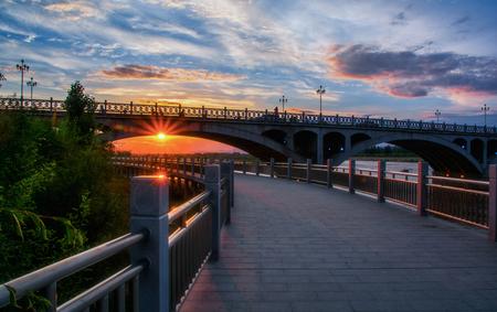 Sunset of Yili bridge in Yining, Xinjiang Imagens