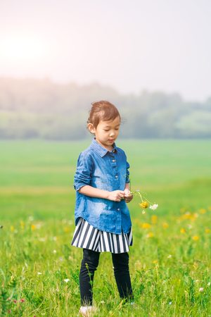 A girl playing on the prairie Stock Photo