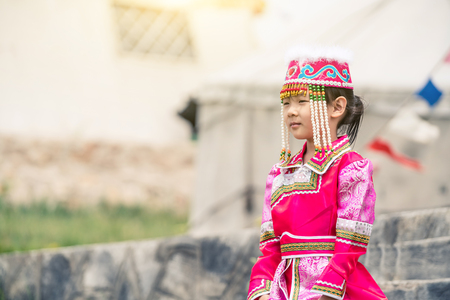 A girl in a Mongolia dress 版權商用圖片