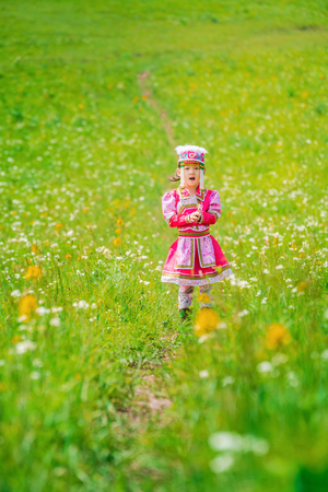 Chinese little girl in traditional Mongolian costume