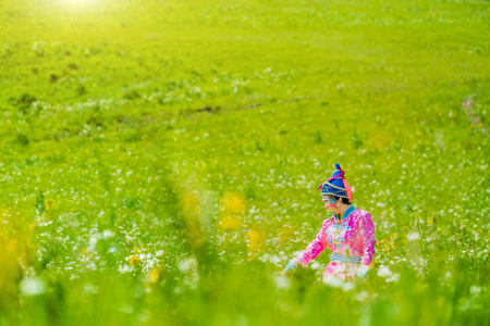 Woman in Mongolian costume on the prairie