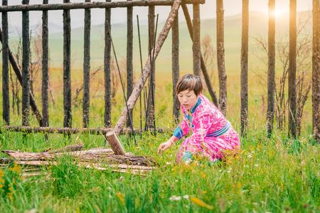 Mongolian woman picking up firewood Reklamní fotografie
