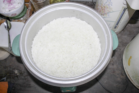 cookers: Rice cookers are typically used for the preparation of plain or lightly seasoned rice. Some also have settings for congee, a type of rice porridge called okayu in Japanese, juk in Korea, and zhou in Chinese. More elaborate recipes are possible using a ric Stock Photo