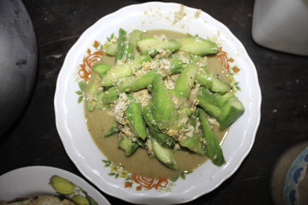 Peel the zucchini and clean. Cut diagonally, into medium sized pieces. Set pan and oil on fire. When hot, put pork and shrimps in. When they are almost done put in the zucchini. Season with the soy sauce and white sugar, and mix thoroughly. Use the lid of 写真素材