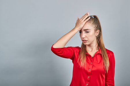 girl brunette in red blouses over isolated white background shows emotions 免版税图像