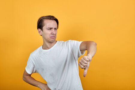 Man shows negative gesture male. Thumb is down Stock Photo
