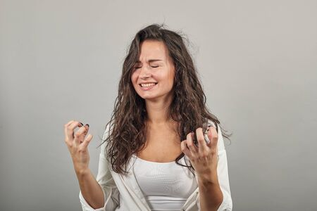 Fingers claw gesture, looks angry hand, shouting, squeez hands in fists losing patience, enraged dissatisfied young grimacing, feeling furious, negative human emotions, feelings and reaction Stock Photo