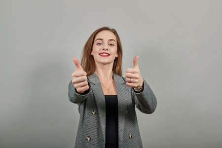 Showing thumbs up, like sign positive something good has happened finger gesture for fine result well done.