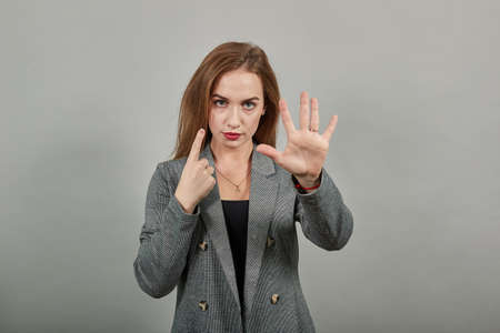 Showing 6 six fingers hand gesture, show the number three with hands, pointing up arm while smiling confident, happy. Stock fotó