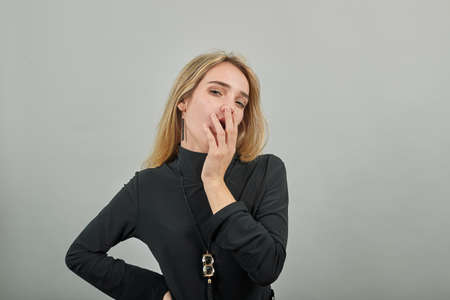 Yawning in office, tired, wide open mouth, eyes closed looking bored. Lack of sleep laziness concept. Sleepy, covering face with hand. Restless and sleepiness. Stock fotó