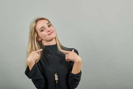 Self assured proud of results satisfied with own high achievements, points two hands at herself, loving smiling gesturing fingers happy. Portrait nice attractive lovely charming pretty cheerful Stock fotó